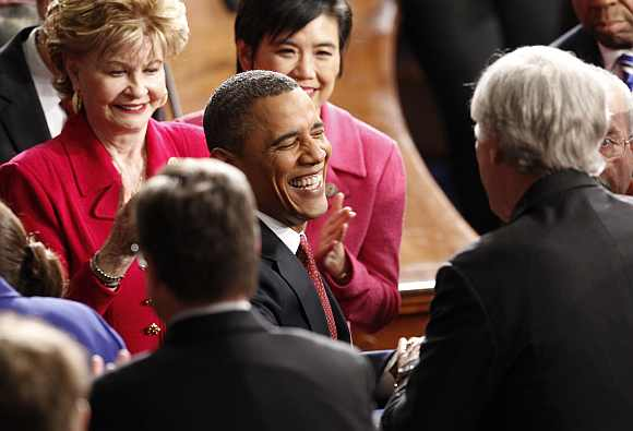 Obama arrives to deliver his State of the Union address to a joint session of Congress on Capitol Hill in Washington