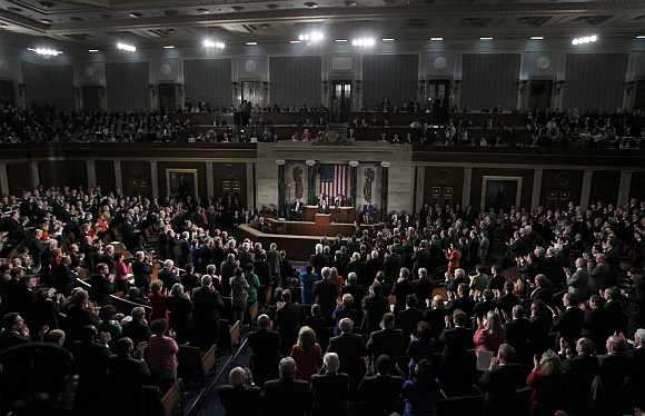 Obama receives a standing ovation as he delivers his State of the Union address to a joint session of Congress on Capitol Hill in Washington