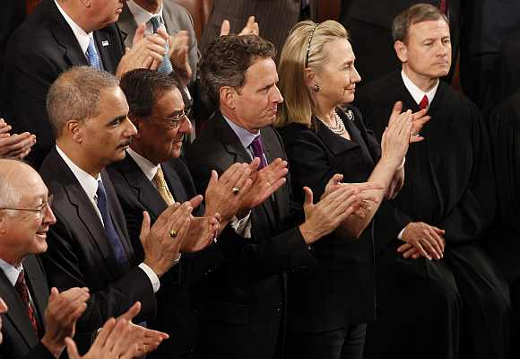 (Left to right) Interior Secretary Ken Salazar, Attorney General Eric Holder, Defence Secretary Leon Panetta, Treasury Secretary Timothy Geithner and Secretary of State Hillary Clinton applaud as Supreme Court Chief Justice John Roberts looks on as U.S. President Barack Obama delivers his State of the Union address
