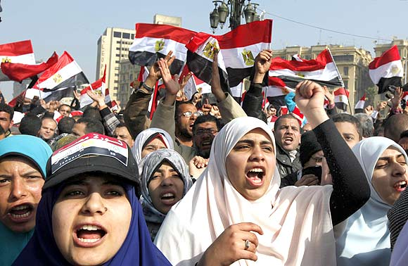 Demonstrators take part in a protest marking the first anniversary of Egypt's uprising at Tahrir square in Cairo