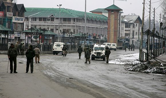 Security personnel patrol the Lal Chowk locality