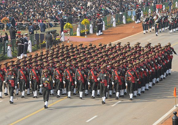 Assam Rifles marching contingent passes through the Rajpath