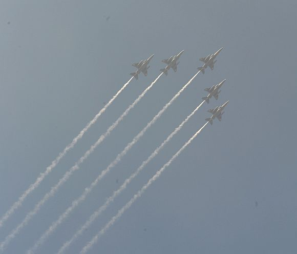 IAF fighter jets in formation fly over Rajpath