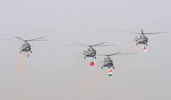IAF Helicopters carrying the tricolour and three services flag