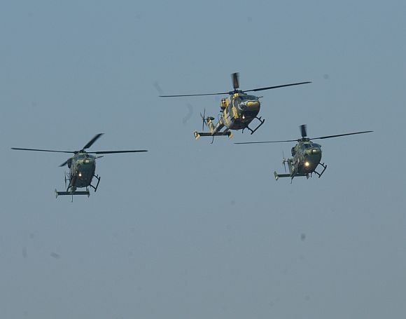Indian Army's Advanced Light Helicopters fly past over Rajpath