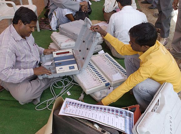 A polling officer checks EVMs in Allahabad