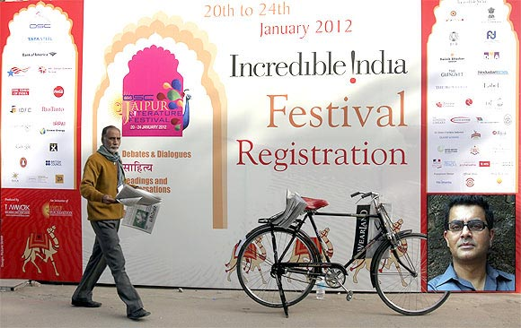 A billboard for the Jaipur Literary Festival. Inset, writer Amitava Kumar