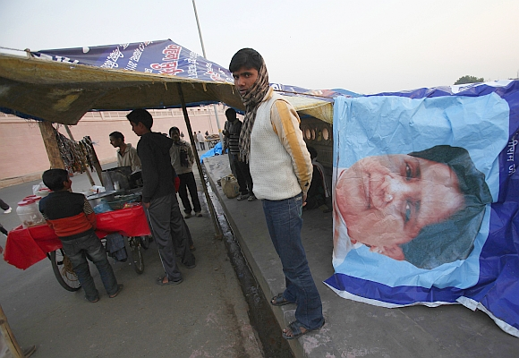 A tea stall vendor uses a banner of Mayawati to cover his roadside shop in Lucknow