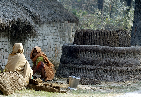Dalit women work with cow dung on the outskirts of Lucknow