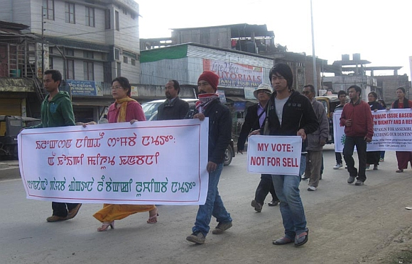Activists of a peoples' rights group in Imphal with their banner