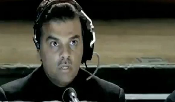 A grab from the controversial Stupidisco music video shows Mansoor Ijaz as a commentator for a women's wrestling bout