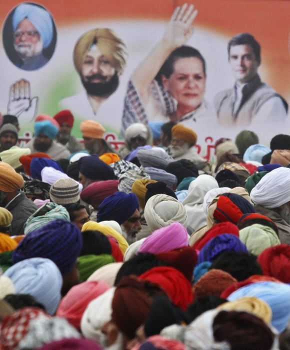 People attend an election campaign rally at Moga in Punjab