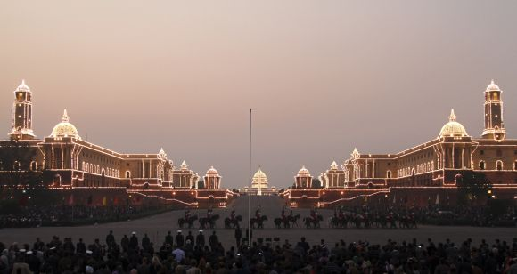 The Indian Defence Ministry (L), Home Ministry (R) and Presidential Palace (C) buildings are illuminated at the Beating the Retreat ceremony in New Delhi