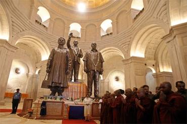 Dalit icons in bronze: Mayawati and her mentor Kanshi Ram flank Dr B R Ambedkar
