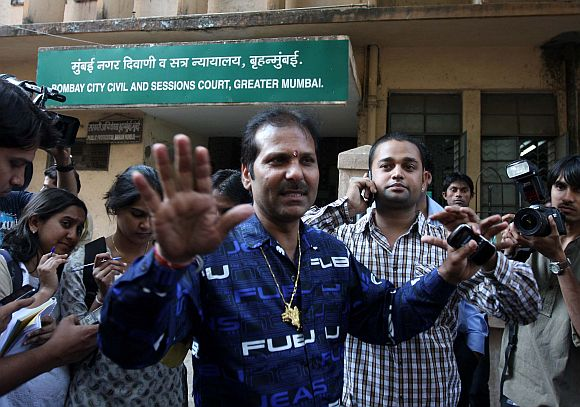 Accused Ayush Bhat's father Arun Bhat (in blue shirt) and Yash Bhat (in green shirt) speaking to mediapersons outside the sessions court in Mumbai on Monday