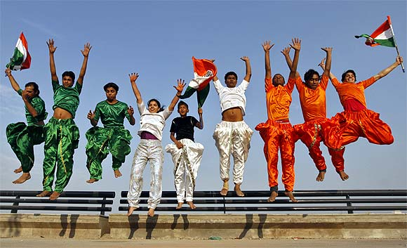 College students dressed in the colours of India's national flag rehearse for the Republic Day parade