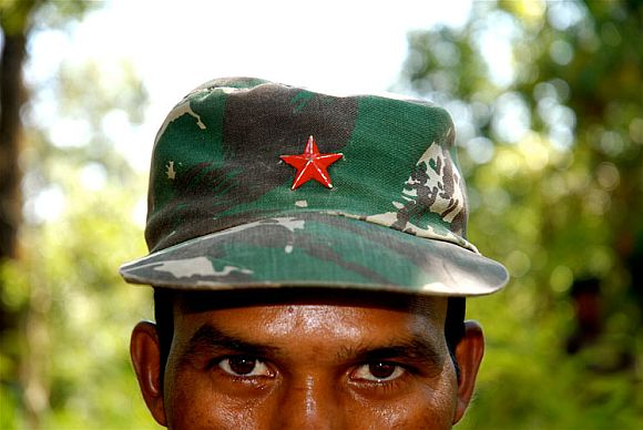 A Naxal fighter at remote camp in Bastar