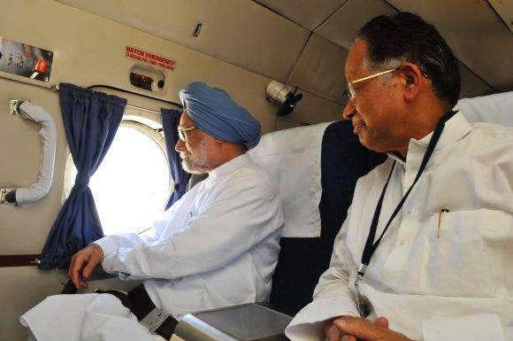PM Singh with Assam CM Gogoi during the aerial survey of flood-affected districts on Monday