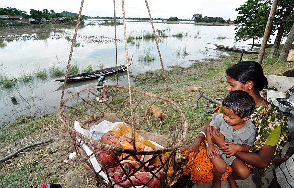 A flood affected family from Mur Kota village takes shelter on high ground