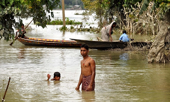 The flood-affected people of Naleni village of Assam move to safer place