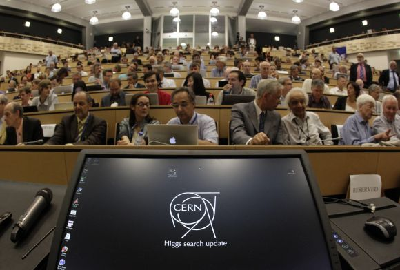 A computer screen is pictured before a scientific seminar to deliver the latest update in the search for the Higgs boson at the European Organization for Nuclear Research (CERN) in Meyrin, near Geneva