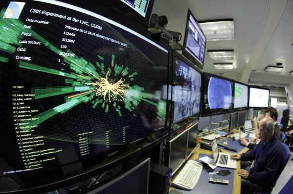 A graphic showing a collision at full power is pictured at the Compact Muon Solenoid (CMS) experience control room of the Large Hadron Collider at the European Organisation for Nuclear Research in Meyrin, near Geneva