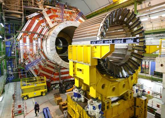 A technician walks under the core magnet of the CMS experiment at the European Organization for Nuclear Research CERN in the French village of Cessy, near Geneva