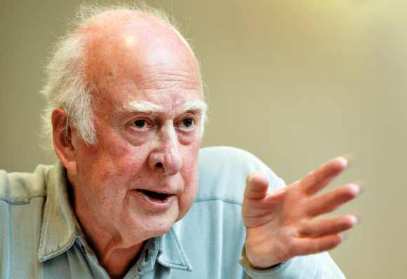 British physicist Peter Higgs gestures during a press conference at CERN