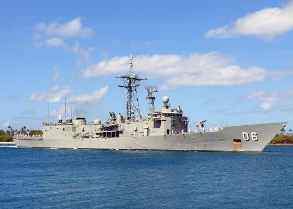 The Royal Australian Navy Adelaide-class guided-missile frigate HMAS Newcastle pulls into Joint Base Pearl Harbor-Hickam, Hawaii, to support Rim of the Pacific exercises
