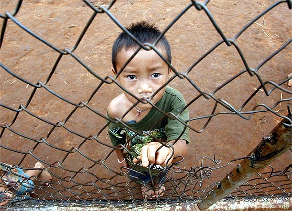 A refugee from Laos stands in Ban Huay Nam Khao camp in Phetchabun province, about 416 km northeast of Bangkok
