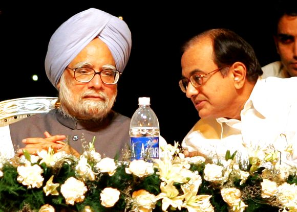 PM Singh and Home Minister P Chidambaram speak during a function in New Delhi