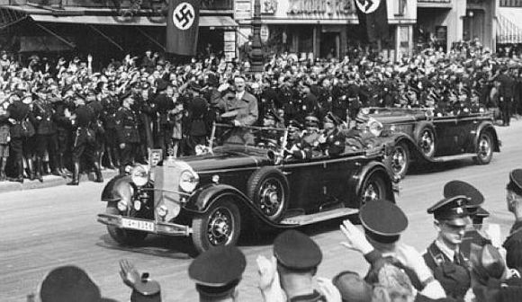 Hitler is seen riding on one the cars in his Mercedes fleet in this undated photo