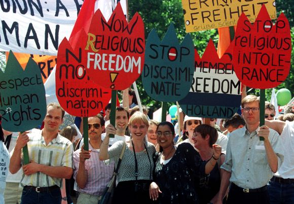 Members of the Church of Scientology hold placards during a demonstration in Frankfurt