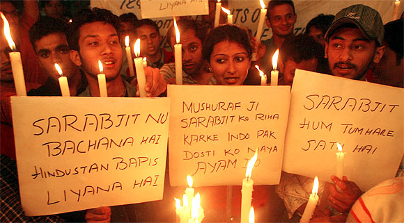 Students take part in a candle-light march for Sarabjit