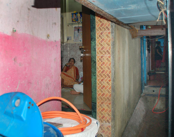 Tushar's mother inside her house as seen from the passageway