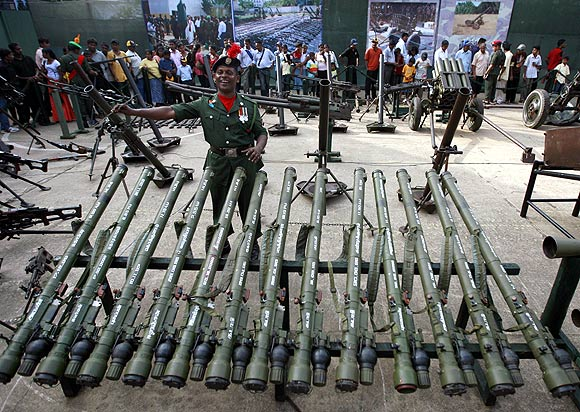 A solider describes a display of weapons captured from the Liberation Tigers of Tamil Eelam in Colombo