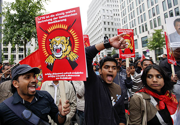 Supporters of Liberation Tigers of Tamil Eelam take part in a protest in Berlin