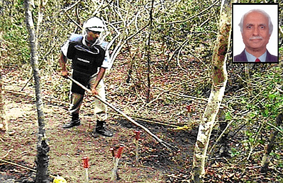 Deminers work in a minefield in Sri Lanka. (inset) Horizon's Chairman Major General S G Pitre