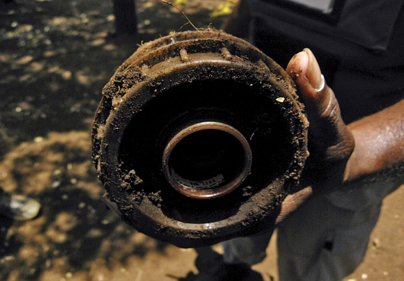 A de-miner shows anti-personnel landmine laid by separatist Tamil Tigers in Sri Lanka