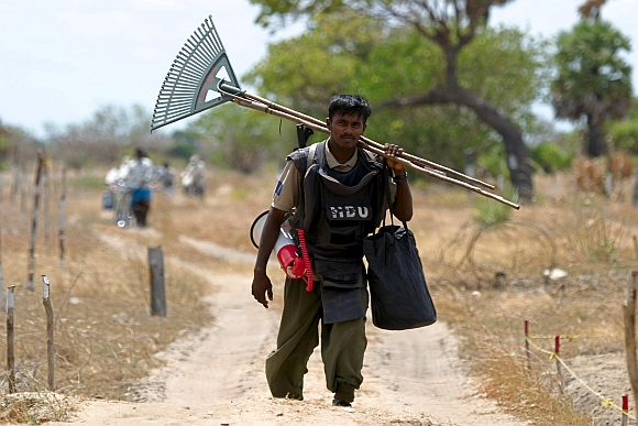 A de-miner walks home after working on a minefield at Elephant Pass in Sri Lanka's northern Jaffna peninsula