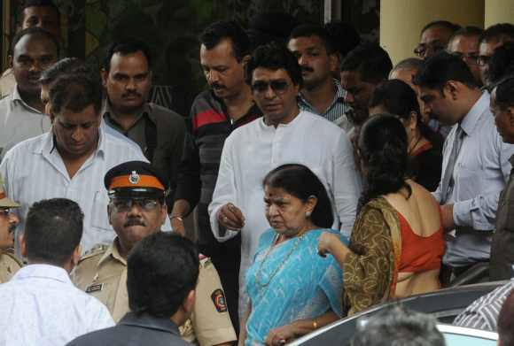 MNS chief Raj Thackeray with his mother outside Lilavati Hospital