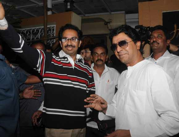 Uddhav and Raj Thackeray pose for the media outside Bandra's Lilavati Hospital
