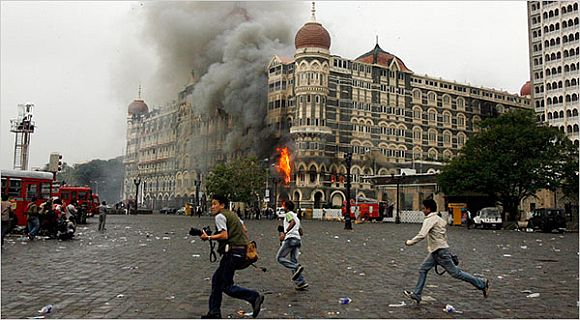 Flames and smoke pour from Hotel Taj Mahal in Mumbai during the 26/11 attacks