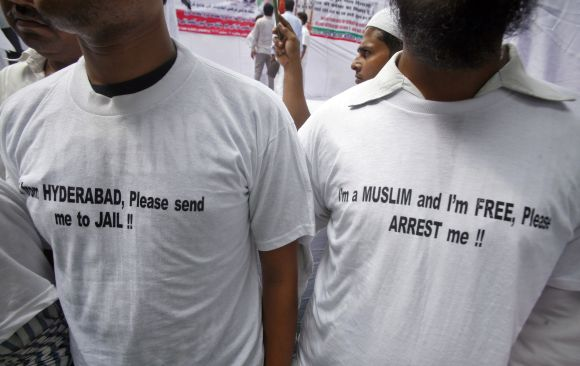 Members of a Muslim organisation take part in a protest rally in New Delhi