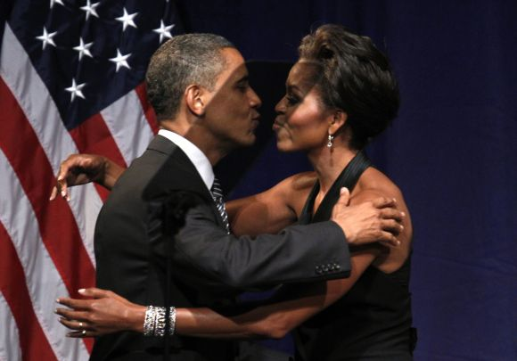 United States President Barack Obama kisses first lady Michelle Obama after she introduced him to speak at a fund raiser in New York
