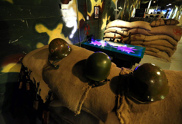 Dine amid landmines, ammo at China's military bar