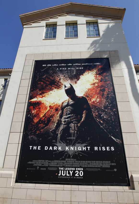 A poster for the Warner Bros film 'The Dark Knight Rises; is displayed at Warner Bros. studios in Burbank, California