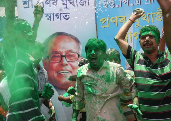 Supporters of Pranab Mukherjee celebrate on the streets of Kolkata on Sunday