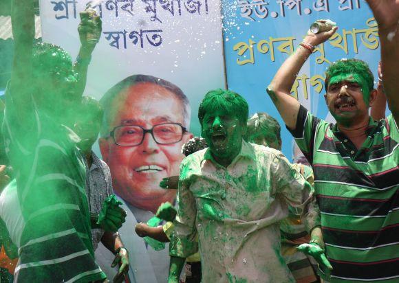 Supporters of Pranab Mukherjee celebrate on the streets of Kolkata o