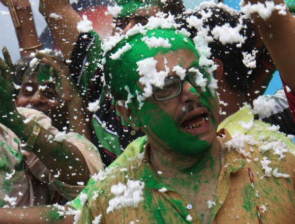 Congress supporters erupt into celebrations in Kolkata on Thursday